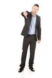 Ung affärsman som ner gör en gest tummar Arkivbilder