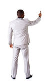 Ung affärsman som pekar på kopieringsutrymme. tillbaka sikt. royaltyfri foto
