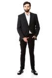 Ung affärsmankänsla smärtar i hans klyka Royaltyfri Foto