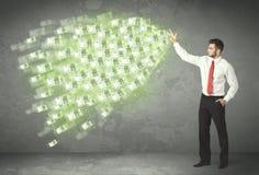 Ung affärsperson som kastar pengarbegrepp Royaltyfri Foto