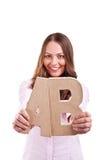 Ung affärskvinna med bokstäver ab Arkivfoton