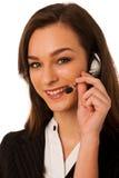 Ung affärskvinna med hörlurar med mikrofon som isoleras över vit bakgrund Arkivfoton