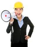 Ung affärskvinna Shouting Into Megaphone Fotografering för Bildbyråer