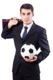 Ung affärsman med fotboll Fotografering för Bildbyråer
