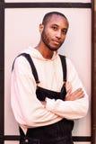 Ung afrikansk grabb med haklappflåsanden utomhus fotografering för bildbyråer