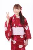 Ung asiatisk kvinna i kimono Arkivfoton