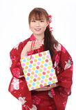 Ung asiatisk kvinna i kimono Royaltyfri Bild