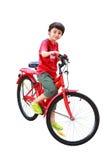 Ung asiatisk pojke på cykeln Arkivbild