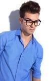 Ung attraktiv affärsman som ner ser Fotografering för Bildbyråer