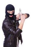 Ung bandit med vapnet Arkivfoto