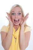 Ung blond förvånad kvinna fotografering för bildbyråer
