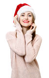 Ung blond flicka som hatten för santa ` s Royaltyfria Bilder