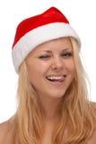 Ung blond kvinna, i att blinka för santa hatt Royaltyfri Foto