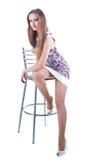 Ung blond kvinnlig på stolen Arkivfoton