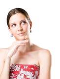 Ung brunettskönhet med tänkande gest. Royaltyfri Fotografi