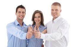 Ung businessteam som ger upp tumen Fotografering för Bildbyråer
