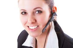 Ung call centeranställd med en hörlurar med mikrofon Royaltyfria Foton