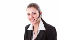 Ung call centeranställd med en hörlurar med mikrofon Royaltyfria Bilder