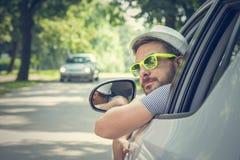 Ung chaufför i driver'splats Arkivbilder