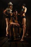 Ung cowboy med flickor Arkivbilder