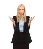Ung förvirrad affärskvinna med händer upp Royaltyfria Bilder