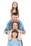 Ung familj med två ungar Royaltyfria Bilder