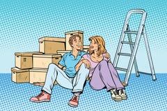 Ung familj som flyttar sig till ett nytt hus royaltyfri illustrationer