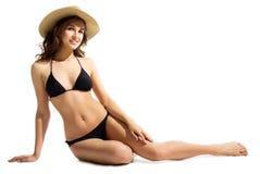 Ung flicka i bikini arkivbild
