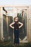 Ung flicka i djur lantgård Royaltyfria Foton