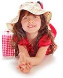 Ung flicka i en röd klänning Arkivfoto