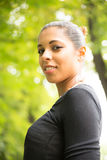 Ung flicka i parken Fotografering för Bildbyråer