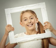 Ung flicka i ram Fotografering för Bildbyråer