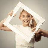 Ung flicka i ram Arkivbilder
