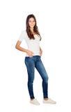 Ung flicka med att stå för jeans royaltyfri fotografi