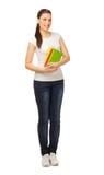Ung flicka med böcker Arkivbild