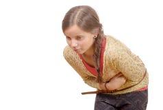 Ung flicka med bukknip som isoleras på vit fotografering för bildbyråer