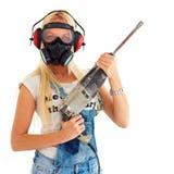 Ung flicka med den skyddsuppsättningen och drillborren Arkivbilder
