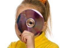 Ung flicka med en cd-skiva Royaltyfri Bild