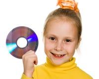Ung flicka med en cd-skiva Arkivfoto