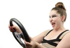Ung flicka med ett styrningshjul Royaltyfri Bild