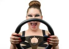 Ung flicka med ett styrningshjul på white Fotografering för Bildbyråer