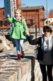 Ung flicka med farmodern på pir Royaltyfri Fotografi