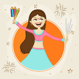 Ung flicka med firecrackeren för Diwali beröm Arkivfoto