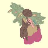 Ung flicka med långt hår i en naturlig krans Arkivbild