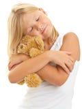 Ung flicka med nallebjörnen Royaltyfri Bild