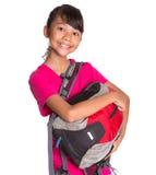 Ung flicka med ryggsäck XV Arkivbild