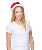 Ung flicka med x-mas-hatten Fotografering för Bildbyråer