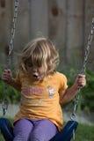 Ung flicka på swing Arkivfoton
