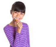 Ung flicka som borstar tänder II Fotografering för Bildbyråer