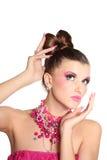 Ung flicka som en docka i rosa klänning Arkivbilder